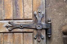 Europe, Romania. Brasov. Detail Of Church Exterior. Wood Door Hinge.
