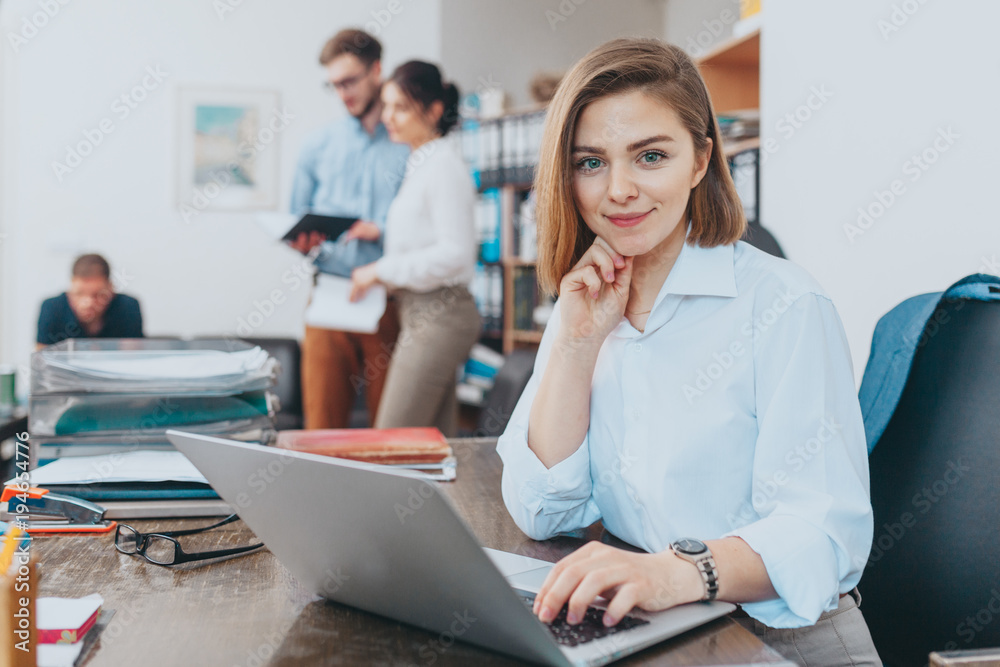 Fototapeta Young woman reading email