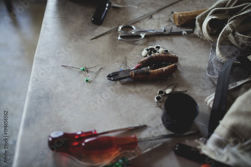High angle view of various tools on table at workshop