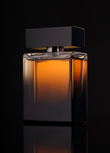 Perfume Bottle Over Black Back...