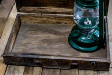 Oil Lamp In An Old Wooden Case...