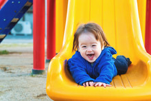 Happy Toddler Boy Playing On A...