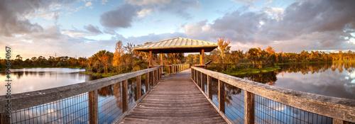 Fotografía Sunset over Gazebo on a wooden secluded, tranquil boardwalk