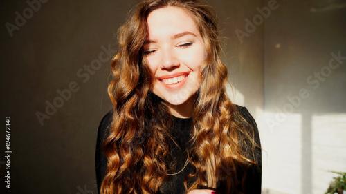 Valokuva  Female Smiling, Looking at Camera, Laughs or Flirts