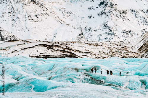 Printed kitchen splashbacks Glaciers mountaineers hiking a glacier in iceland