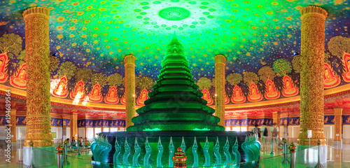 Garden Poster Temple Golden pagoda with lighting inside at Wat Paknam Bhasi Charoen
