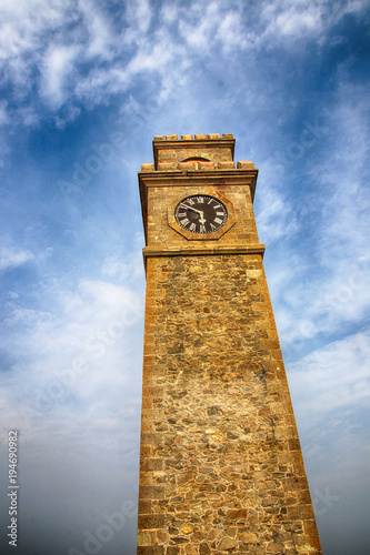 Fotografie, Obraz  Galle Clock Tower (Anthonisz Memorial Clock Tower) against a blue sky in the Gal