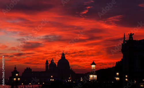 Poster Rome Red blood sky sunset over Venice Lagoon with Salute Basilica domes Saint Mark Lion and lamps