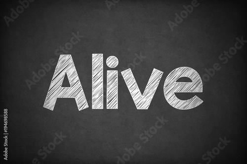 Photo  Alive on Textured Blackboard.