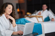 Couple relaxing and working from hotel room