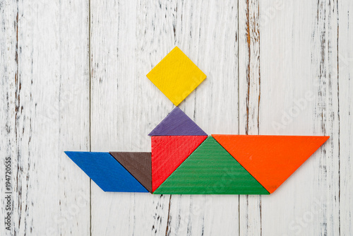 Poster Graffiti wooden tangram shaped like a people sitting on a boat