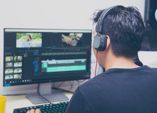 Back View Of Video Editor Usin...