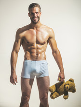 Unshaven, Naked, Satisfied, Sexy, Attractive Gay With Muscular Torso Holds Teddy Bear. Sexy, Charming, Romantic, Happy, Athletic, Strong Boyfriend Keeps Fluffy, Soft, Plush Toy. Furry Plush Toy, Teddy