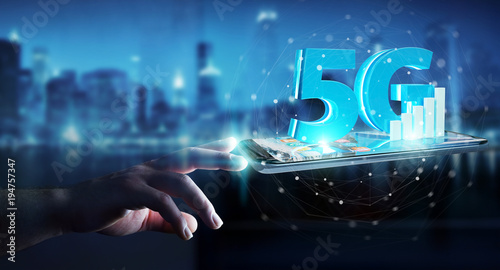 Cuadros en Lienzo  Businessman using 5G network with mobile phone 3D rendering