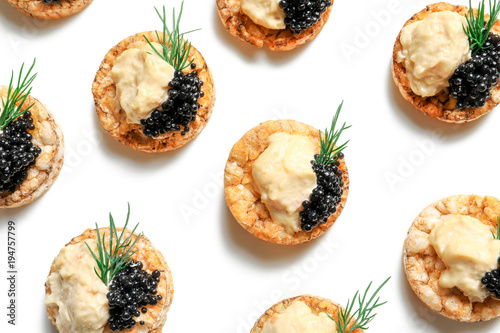 Tasty black caviar appetizer on white background