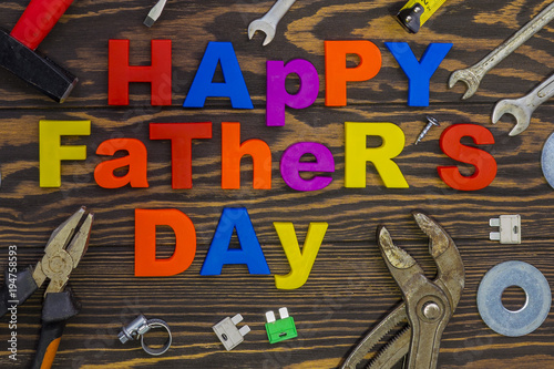 Happy Father\'s Day inscription with work tools on wooden background ...