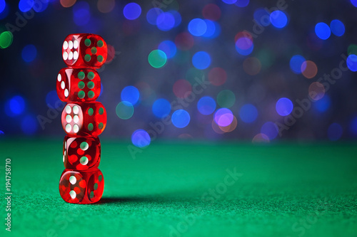 Dices on green table in casino плакат