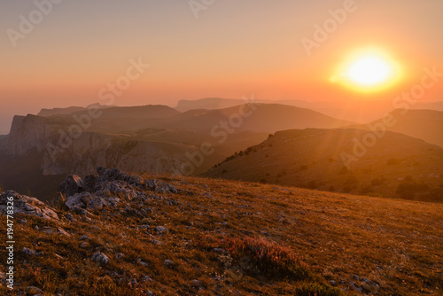 Foto op Aluminium Zalm Mountain landscape at sunset in the summer
