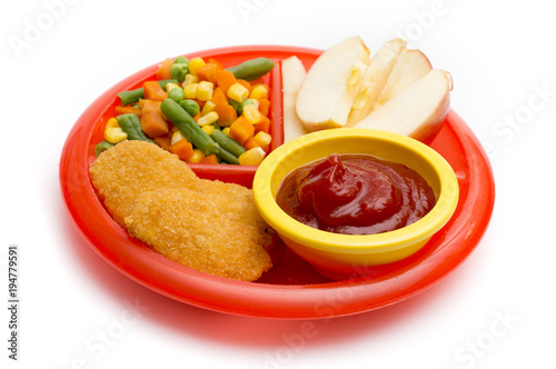 Children's Plate with a Well Balanced Meal of Chicken Nuggets, Vegetables and Sliced Apple