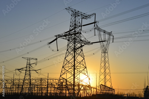 The silhouette of the evening electricity transmission pylon Poster