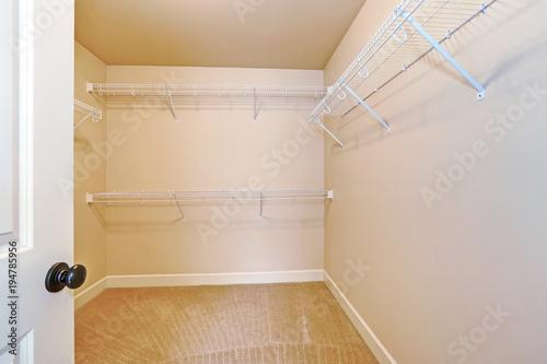 empty walk in closet. Empty Walk In Closet With Shelves And Carpet Floor. W