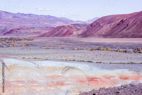 Photo Stands Candy pink Colorful pink hills under the Sunny sky. Rocks and mountains of pastel colours.