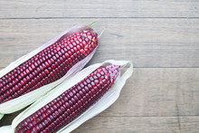 Siam Ruby Queen Sweet Corn On Wooden Background