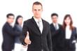 Businessman offering handshake on group of business background