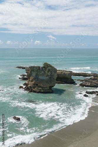 Foto op Aluminium Oceanië Pancake rock on sand beach, Panakaiki South Island New Zealand natural landscape