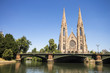 St. Paul's Church, a major Gothic Revival Lutehran church and one of the landmarks of the city of Strasbourg, in Alsace, France, with the River Ill