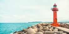 Panoramic View On Red Color Lighthouse At Jeju Island - South Korea