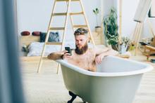 Young Caucasian Beard Man Sitt...