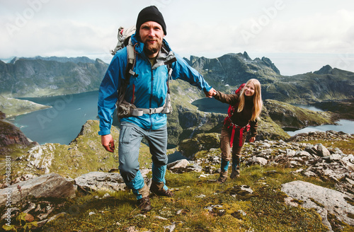 Fototapeta Happy Couple hiking in Norway mountains love and travel holding hands man and woman together Lifestyle concept vacations outdoor obraz na płótnie