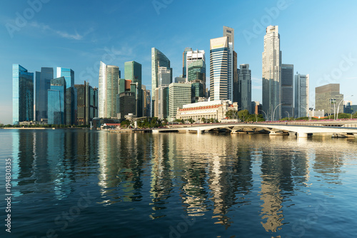 Obraz na plátne  Singapore business district skyline and skyscraper in morning at Marina Bay, Singapore