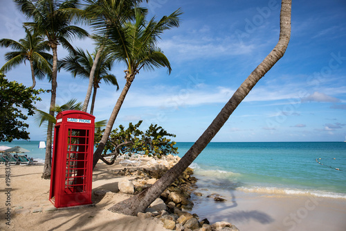Fotografie, Obraz  Phone booth in Dickenson Bay on Antigua in the Caribbean