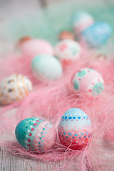 Painted Easter eggs on old boards , Easter background
