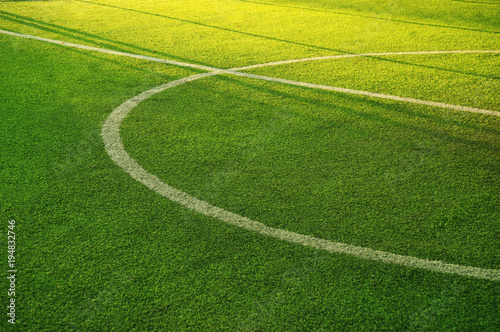 Obraz white circle line on green grass of football of soccer sport field background - fototapety do salonu