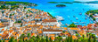Leinwanddruck Bild - Hvar island panorama landscape. / Panorama of amazing coastal town Hvar in Croatia, popular mediterranean tourist resort in summertime, Europe.