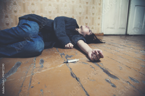 sad woman lying floor and needle - Buy