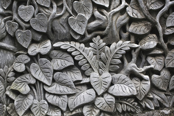 Ornamental bas-relief of a jungle carved in an old tree