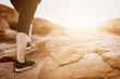 woman legs climbing to mountain peak