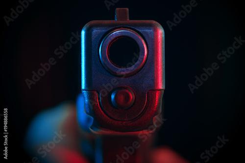 Fényképezés  Pistol pointed at point blank range