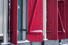 Bright Red Shutters And Window...