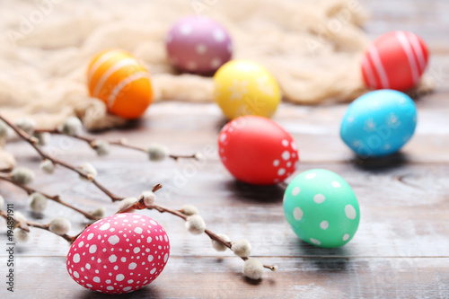 Fotografie, Obraz  Colorful easter eggs on wooden table