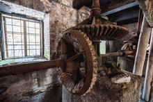 Old Abandoned Watermill Interior And Metal Tool.