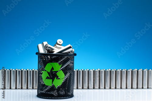Photo Ecology recycling concept, nature energy, used or new battery on recycle garbage