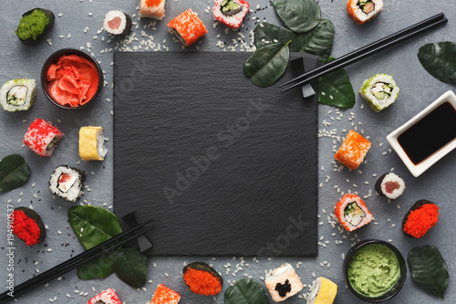 Printed kitchen splashbacks Sushi bar Square black slate with sushi on grey background