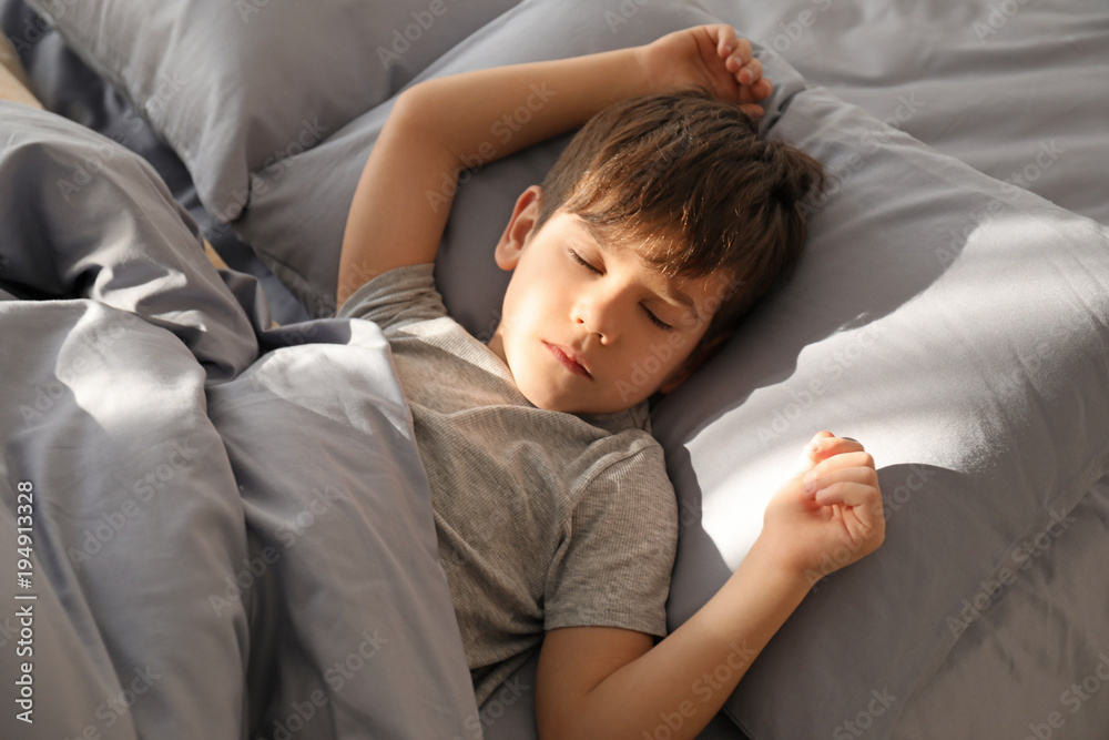 Fototapety, obrazy: Cute little boy sleeping in bed at home