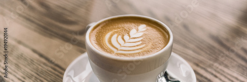 Coffee cup with latte art on cafe wood table banner panorama background Fototapete