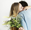 Woman receive a bouquet of flower from her lover